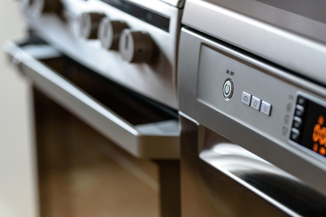 close up shot of two ovens next to each other